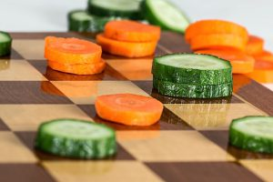 Playing Checkers with Carrots and Cucumbers