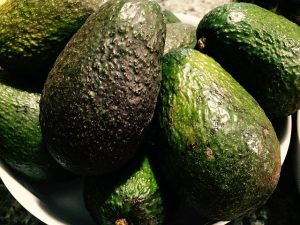 Avocados with skin on.