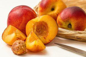Peaches and peach pit.