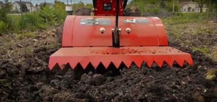Southland SRTT196E rear-tine guard levels tilled soil.