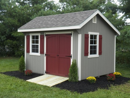 A storage shed with double doors.