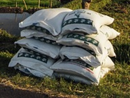 Stacks of fertilizer to be loaded.