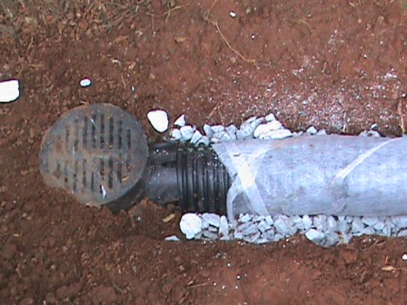 Catch basin drain connected to perforated pipe.