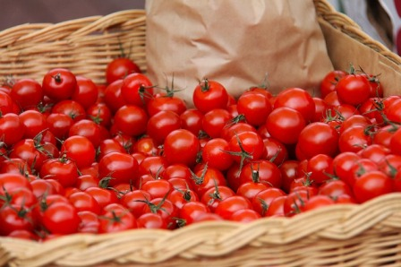 A bushel basket of tomatoes.