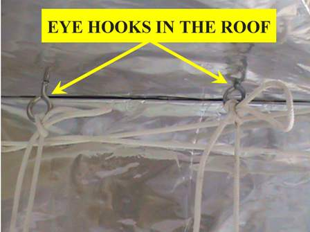 Eye hooks in the roof board.