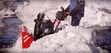 Troy-Bilt Vortex 2690 plowing through the snow.