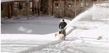 CUB CADET throwing snow