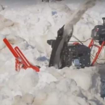 Snow blower auger jammed with snow and ice.