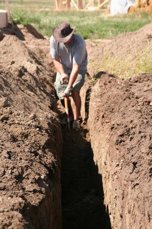 Jim digging a trench.