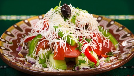 Freeze Dried Mozzarella Cheese On A Salad.