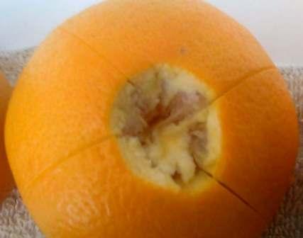score the orange peels into quarters