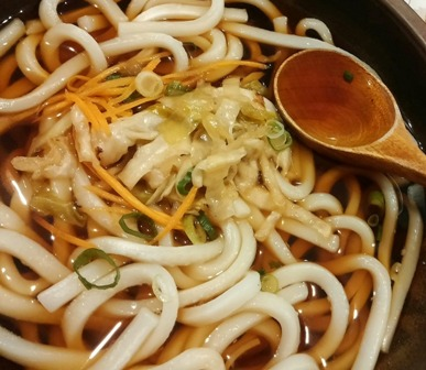 Udon noodles in a soup.
